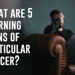 What are 5 warning signs of testicular cancer?